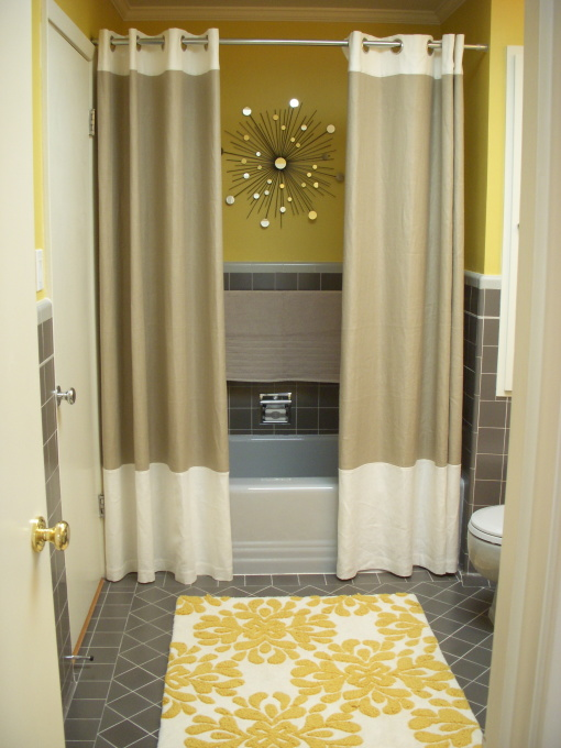 Two shower curtains. Changes the whole feel of a bathroom. Brilliant.