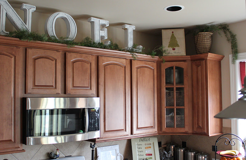 Big Letters And Pine Garland Above The Kitchen Cabinets