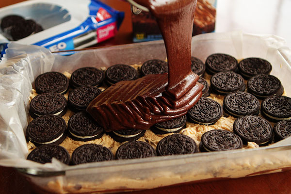 Brownie batter, poured over oreos, arranged over cookie dough, served warm with