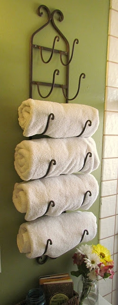 Use a wine rack as towel holder in bath.