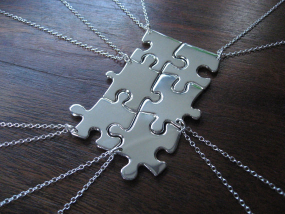Use real puzzle pieces covered in mod podge and pretty paper or spray painted ch