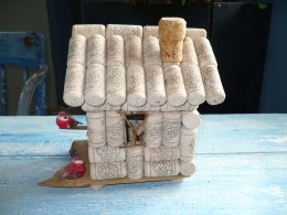 Side of the cork Birdhouse also showing the roof and chimney.