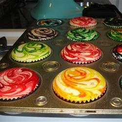 White Cake – Add a couple drops of food coloring and swirl… in the tin so you
