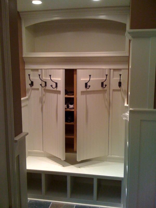 Hidden shoe rack storage behind coat rack. Great idea for mudroom! I love this!