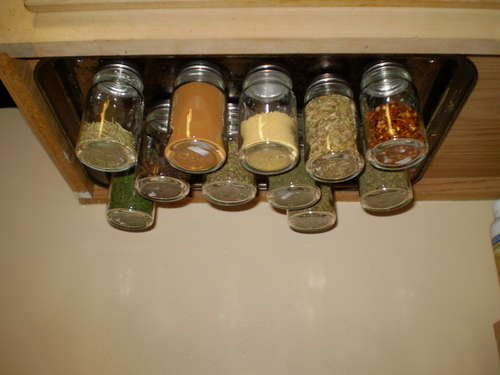 A magnetic spice rack. A cookie sheet screwed to the under side of the cupbaord.