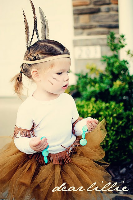 DiY Indian costume with tulle skirt and feather in the hair.