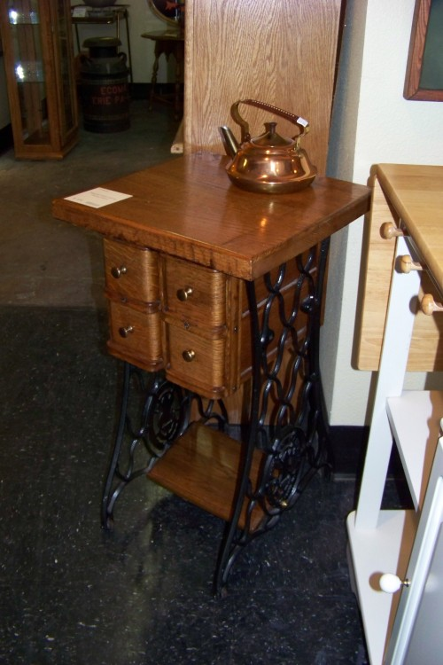 Old sewing machine cabinets with the good parts upcycled.