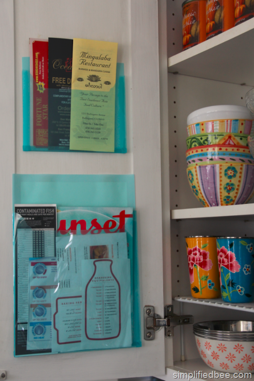 Great idea to hold menus, coupons, loose papers inside a cabinet door….really-