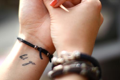 Let go arm text tattoo