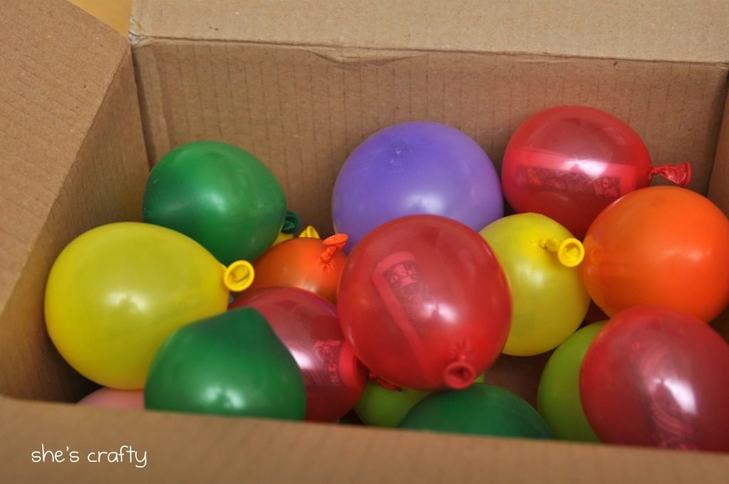 Send a box full of balloons with notes/money inside each one. Won't weigh mu