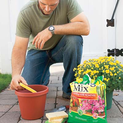 Place a sponge in the bottom of a planter before adding soil, to keep water in r