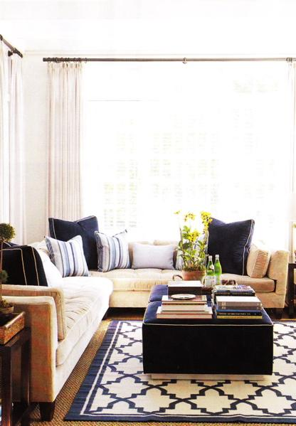 sand beige & navy blue comfy living room design with white paint wall color.