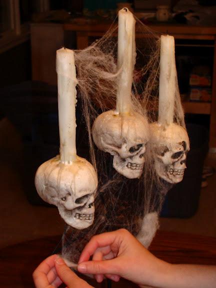 1. DIY: Spooky Halloween Candelabra -   40 Spooky Halloween Decorating Ideas for Your Stylish Home
