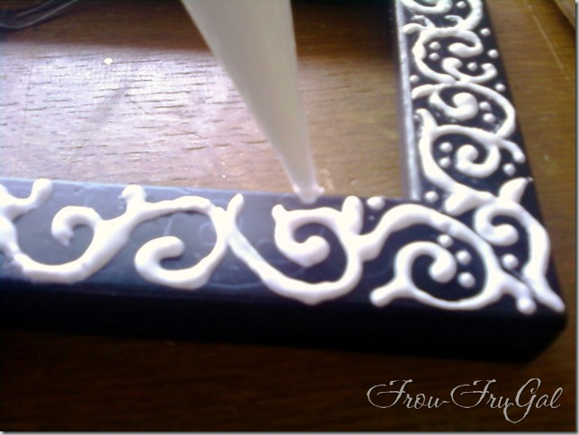 DIY: Dress up a cheap frame by decorating is with glue, let it dry, and then pai