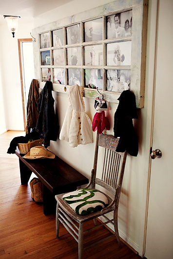 old door with pictures and coat hooks.