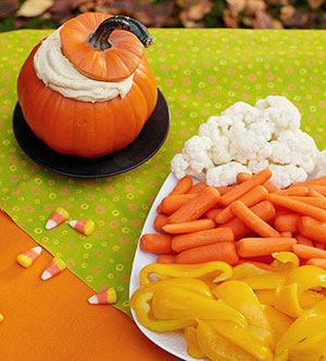 Healthy Halloween snack: Arrange cauliflower, carrots, and yellow peppers in the