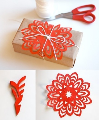 DIY Paper flowers. Cute! A nice way to decorate packages without buying wrapping