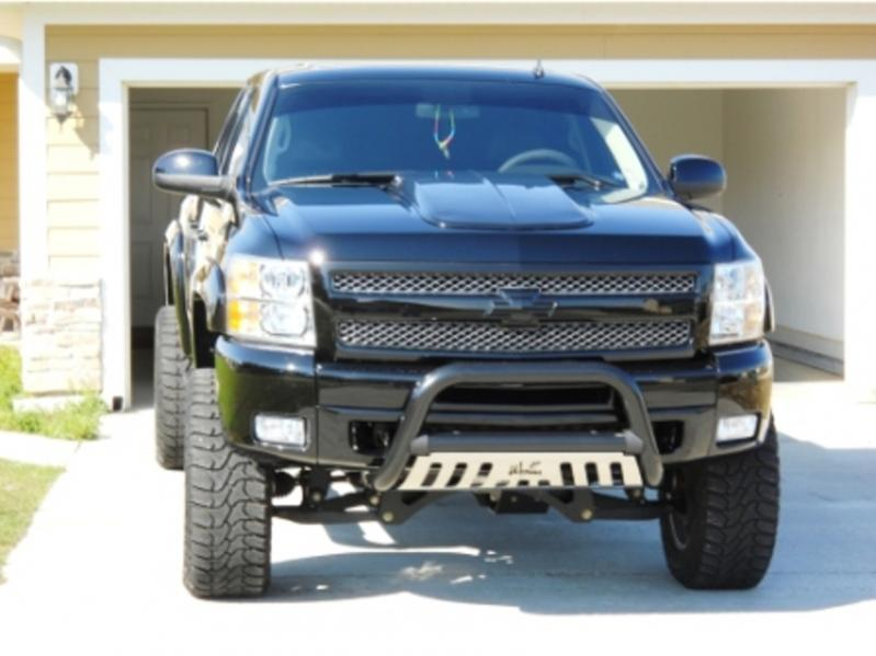 Honey … I'm afraid it's not going to fit into the garage.  2011 Chevy Silverad