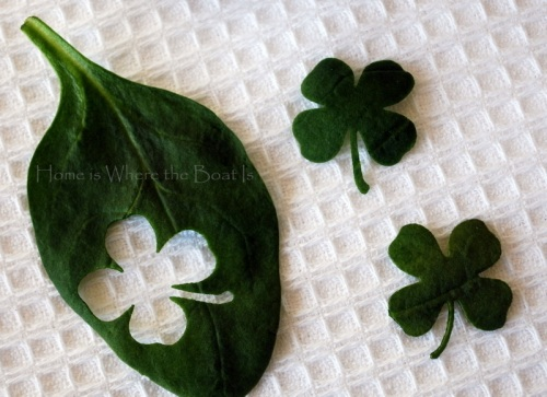 Use a craft punch. (Four leaf clovers out of spinach for topping dishes on St. P