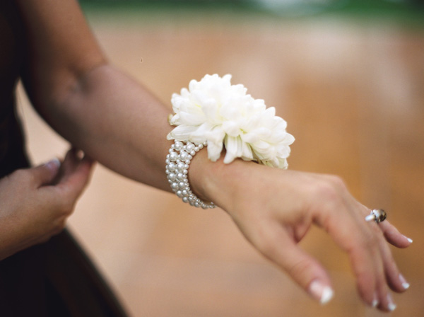 mom and grandma corsage: modern corsage: pearl bracelet with one big bloom. I lo