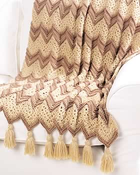 This #crochet ripple afghan pattern calls for elegant beige colors and fancy tas