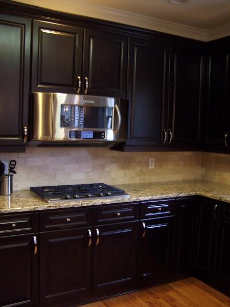 Espresso-stained kitchen cabinetry -   Espresso-stained kitchen cabinetry.