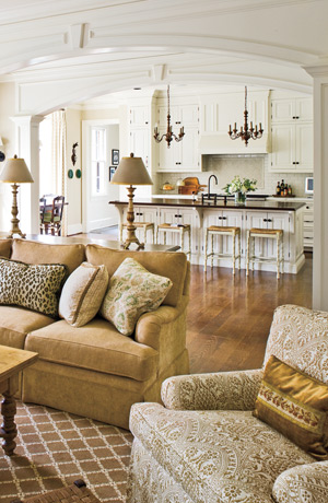 Beautiful kitchen & comfy living room. Love that wide, open archway which pr