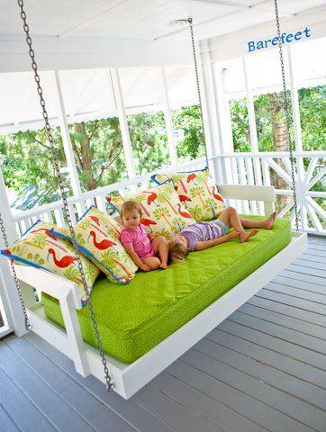 twin bed turned porch swing