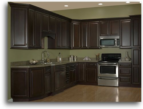 espresso stained cabinets -   Espresso-stained kitchen cabinetry.