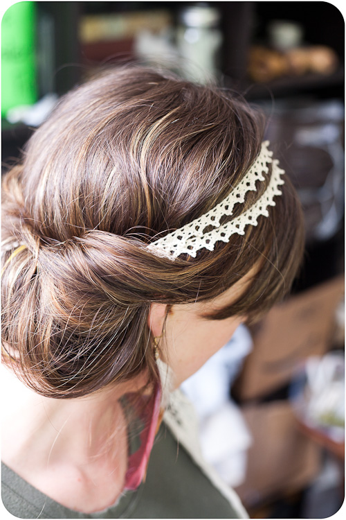 Put the headband on top of your hair (while your hair is down) and then grab you