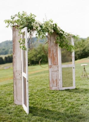 i love this idea for your arch! just buy two really old doors or else just by do