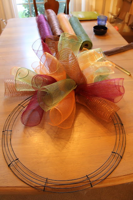 maybe in christmas colors??? :) How To Make A Curly Deco Mesh Wreath – this is s