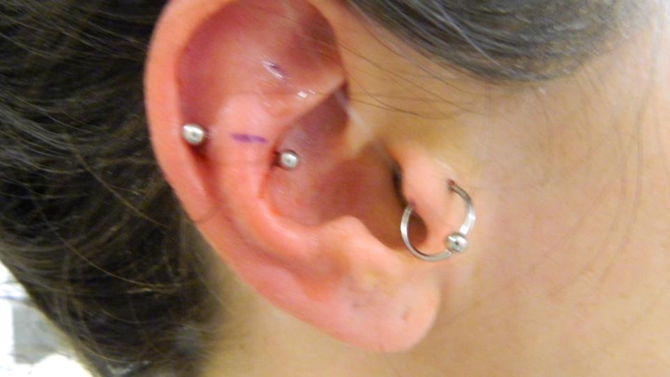 halfway between a rook and a snug. from Only Precision Piercing in Washington SO
