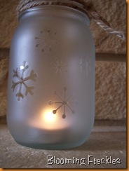 frosting spray paint + mason jars + snowflake stickers.    Ok, I am making this