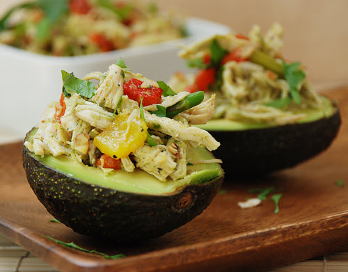 Chicken salad with roasted bell peppers in avocado cups.