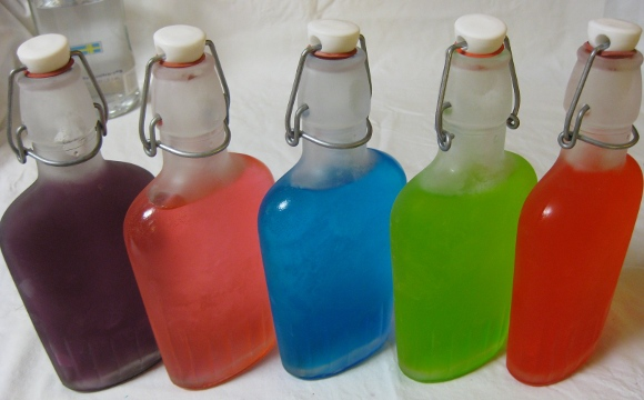 Chilled Jolly Ranchers Vodka in flasks