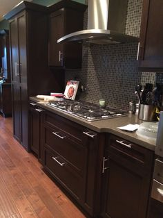 Espresso-stained kitchen cabinetry.