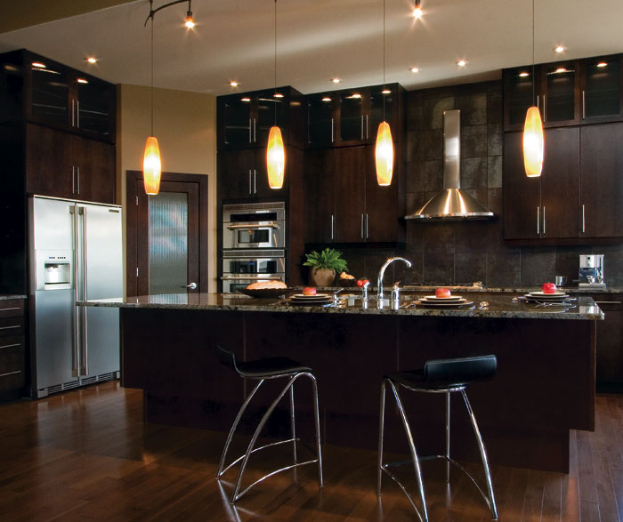 Modern kitchen cabinets in espresso finish by Kitchen Craft Cabinetry -   Espresso-stained kitchen cabinetry.