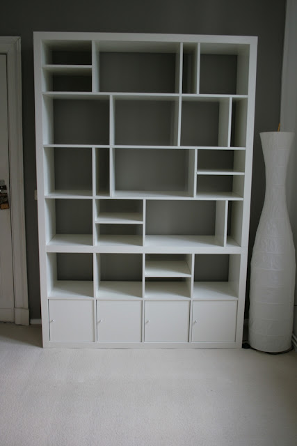 Think outside the box when constructing an Ikea Expedit bookshelf to construct y