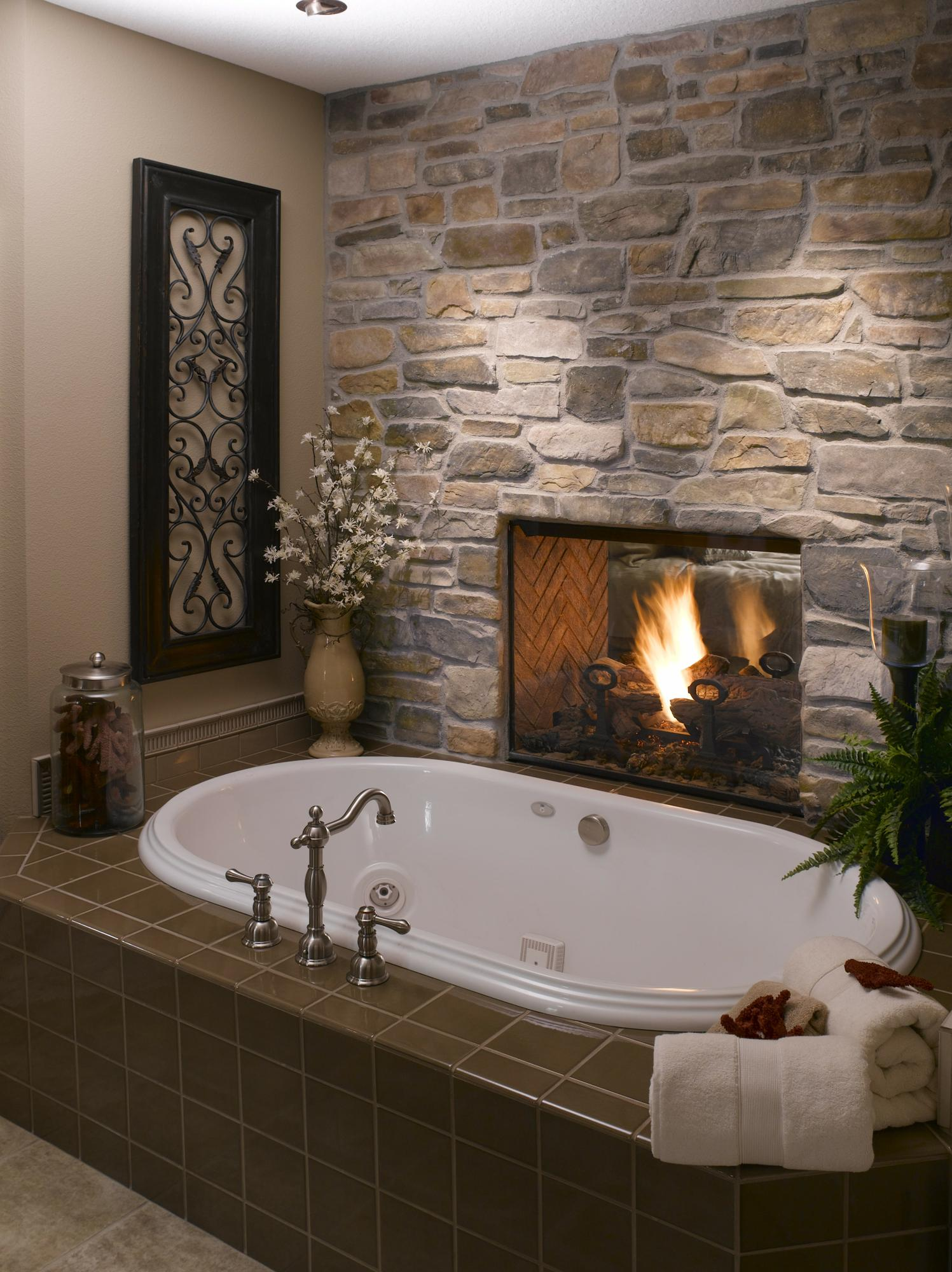 Fireplace between the master bedroom and tub. Yes please!  On vacay I got to tak