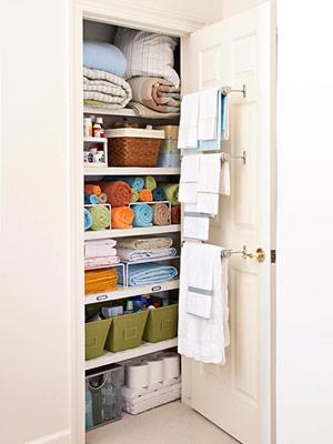 """An organized linen closet.  I love the bars on the door!"" The bars on"