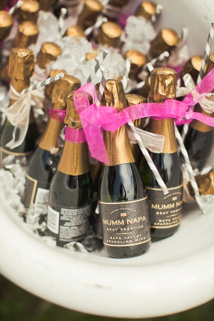 mini champagne bottles with straws and ribbon on New Years Eve so everyone can p