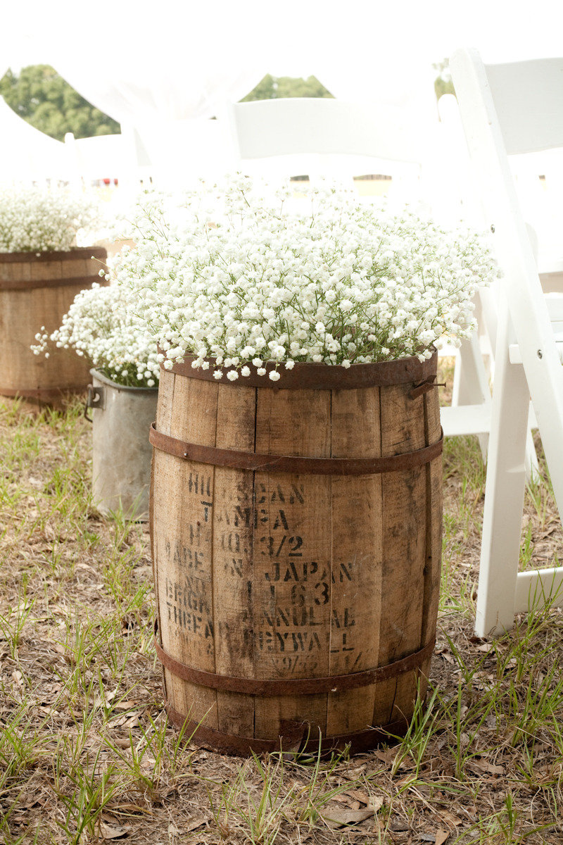 Whiskey barrel & baby's breath to go in front of the arch or in front of