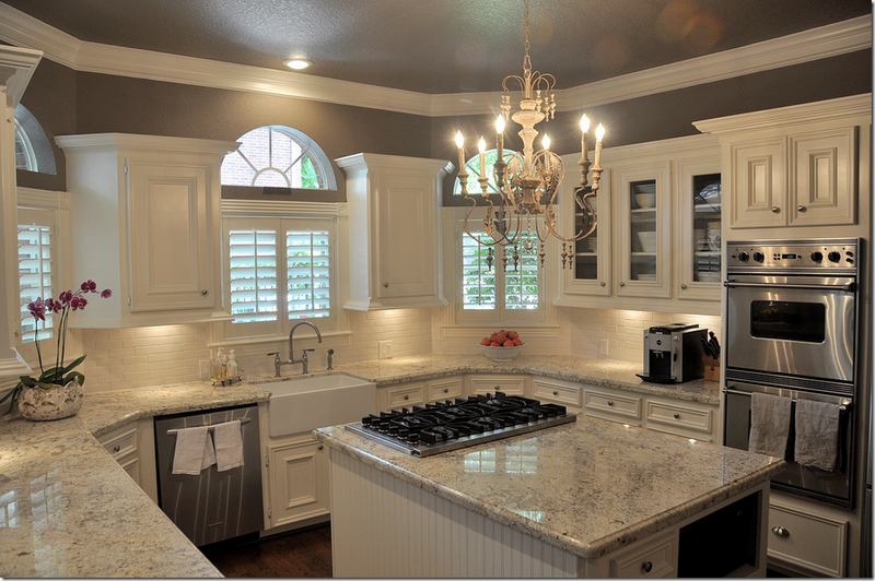 Dark wood floor, white & gray granite, white cabinets, cream backsplash &