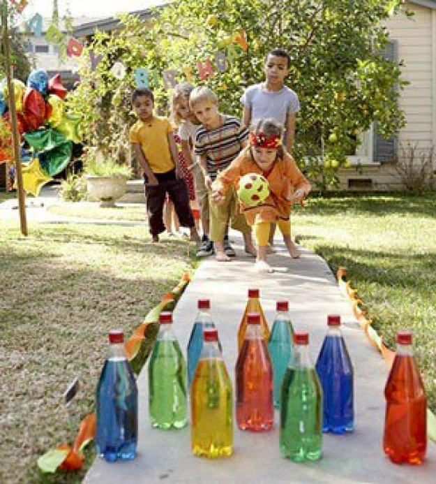 7. Break glow sticks into bottles of water for some nighttime lawn bowling action. -   32 Cheap And Easy Backyard Ideas
