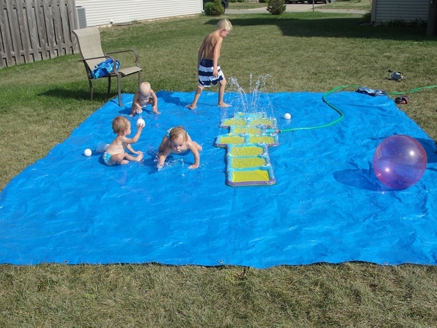 14. But actually, this DIY splash pad made from a tarp is even cheaper. -   32 Cheap And Easy Backyard Ideas