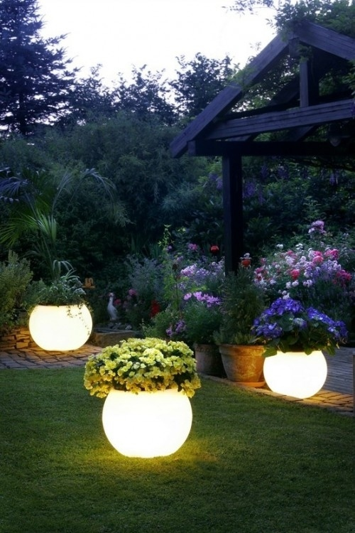 1. Coat planters with glow-in-the-dark paint for instant night lighting. -   32 Cheap And Easy Backyard Ideas