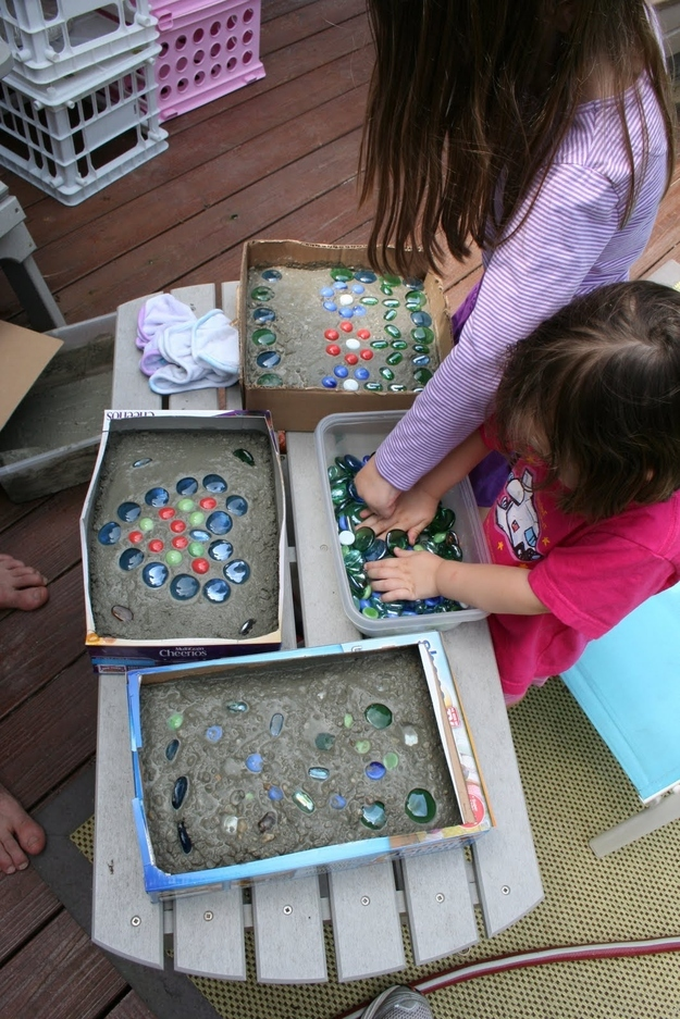 23. Enlist the kids to help you make stepping stones out of cement, cereal boxes, and glass stones. -   32 Cheap And Easy Backyard Ideas
