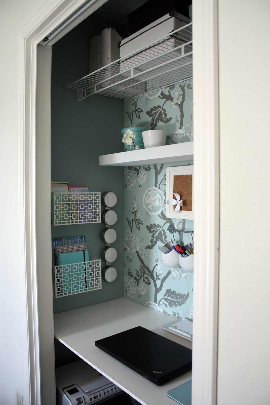 Organize your office with wall shelving and storage boxes.