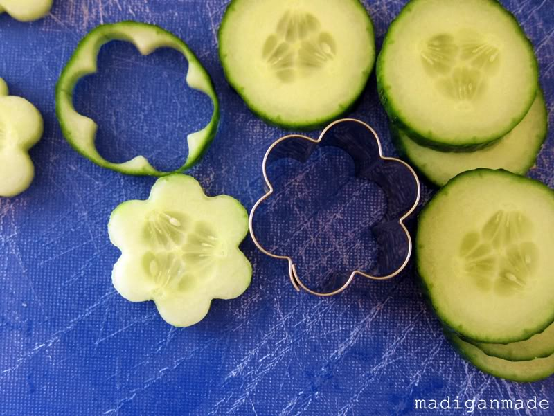 How use a cookie cutter to make cucumber flowers.